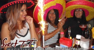 Nerissa Hosein and two women wearing pink yellow red black sombreros clapping drinking Carib, Malta Carib, Smirnoff Ice Vodka, Wine, eating chocolate cake, grilled foods, A1 barbecue sauce, lighting candles, celebrate her Birthday fiesta at Rango's in Chaguanas in Sweet T&T, Sweet TnT Magazine, Trinidad and Tobago, Trini, vacation, travel