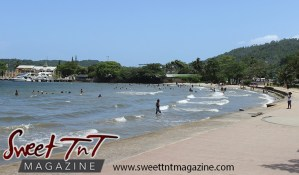 Waves, shoreline, sand, blue sky, people bathing in water at Chaguaramas in Sweet T&T, Sweet TnT Magazine, Trinidad and Tobago, Trini, vacation, travel Chaguaramas Boardwalk
