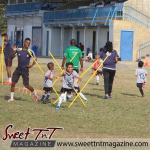 Children run through yellow bars, Football Factory, St Mary's college, CIC grounds, Terry Fenrick, sports in T&T, Sweet T&T, Sweet TnT, Trinidad and Tobago, Trini, vacation, travel