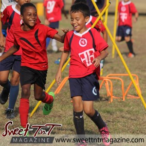 Children laughing on field, Football Factory, St Mary's college, CIC grounds, Terry Fenrick, sports in T&T, Sweet T&T, Sweet TnT, Trinidad and Tobago, Trini, vacation, travel