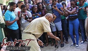 Man entertains young people with snake at Emperor Valley Zoo, Sweet T&T, Sweet TnT, Trinidad and Tobago, Trini, vacation, travel