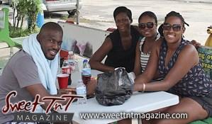 Friends around table at Richard's Bake and Shark, Maracas Beach, Sweet T&T, Sweet TnT, Trinidad and Tobago, Trini, vacation, travel
