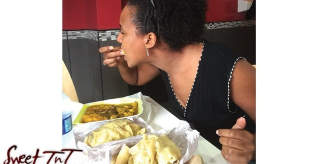 Winta eating curried dish, Sweet T&T, Sweet TnT, Trinidad and Tobago, Trini, vacation, travel,