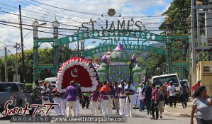 Hosay Muslim men parade in St James in Sweet T&T, Sweet TnT, Trinidad and Tobago, Trini, Travel, Vacation, Tourist, Hosay, Muslim, Parade, Tomb, Drummers, Funeral Procession, Woodbrook, St James, St Clair, Palm, Dancing the moon, Tadjahs, Moons, Tadjahs, mosques, Hussein, Hassan, tombs, tassa side, two moons, Husayn, Hassan