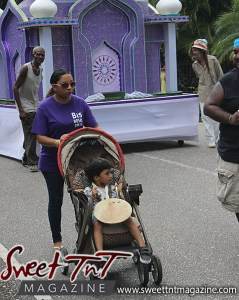 Hosay mother and baby, baby drummer, baby in stroller, baby in stroller on street in strollerSweet T&T, Sweet TnT, Trinidad and Tobago, Trini, Travel, Vacation, Tourist, Hosay, Muslim, Parade, Tomb, Drummers, Funeral Procession, Woodbrook, St James, St Clair, Palm, Dancing the moon, Tadjahs, Moons, Tadjahs, mosques, Hussein, Hassan, tombs, tassa side, two moons, Husayn, Hassan