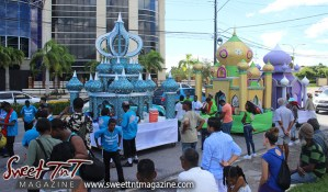 Hosay men parade in street in Sweet T&T, Sweet TnT, Trinidad and Tobago, Trini, Travel, Vacation, Tourist, Hosay, Muslim, Parade, Tomb, Drummers, Funeral Procession, Woodbrook, St James, St Clair, Palm, Dancing the moon, Tadjahs, Moons, Tadjahs, mosques, Hussein, Hassan, tombs, tassa side, two moons, Husayn, Hassan