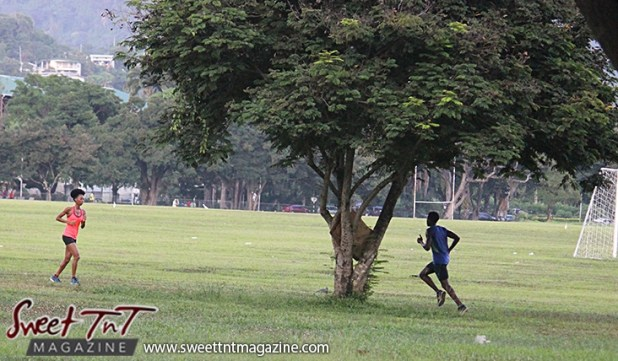 Woman, man jogging Queens Park Savannah Port of Spain for How to lose weight story in Sweet T&T, Sweet TnT, Trinidad and Tobago, Trini, vacation, travel