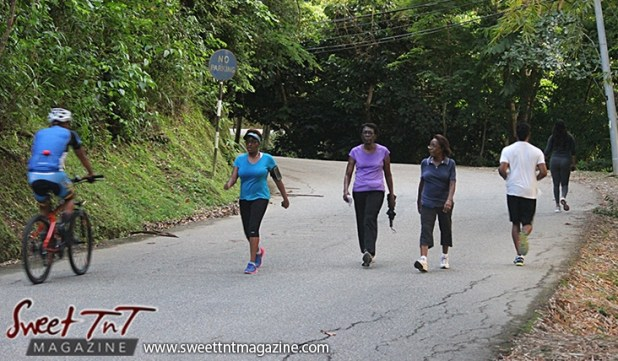 Four women and man walking exercising on Lady Chancellor Hill Port of Spain for story original outdoor gym in Sweet T&T, Sweet TnT, Trinidad and Tobago, Trini, vacation, travel