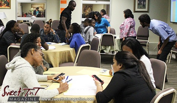 Facilitators assist groups discussing ideas at Launch Rockit in sweet t&t for Sweet TnT Magazine in Trinidad and Tobago