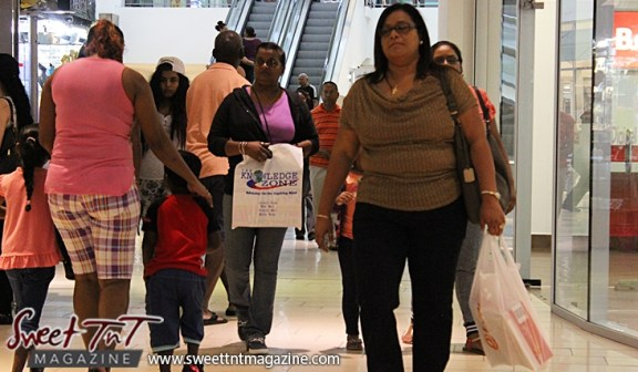 Shoppers with bags at Trincity Mall for holiday in sweet t&t for Sweet TnT Magazine in Trinidad and Tobago