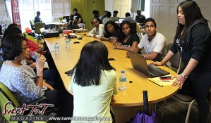 Woman raises hand during presentation of business idea at Launch Rockit business in in 54 hours in sweet t&t for Sweet TnT Magazine in Trinidad and Tobago
