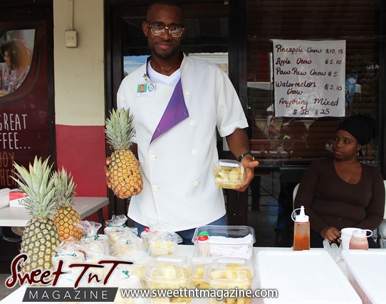 Pineapple chow vendors pose on Ariapita Avenue, Carnival 2017 in sweet T&T for Sweet TnT Magazine, Culturama Publishing Company, for news in Trinidad, in Port of Spain, Trinidad and Tobago, with positive how to photography.