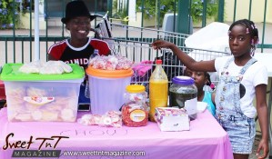 Trinidad and Tobago Carnival Young vendors sell pineapple chow and sweet and salt prunes on Ariapita Avenue, Carnival 2017 in sweet T&T for Sweet TnT Magazine, Culturama Publishing Company, for news in Trinidad, in Port of Spain, Trinidad and Tobago, with positive how to photography.