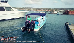 Avenall Bharath on boat before engine fails on journey from Trinidad to Tobago. Photo by Candida Khan.