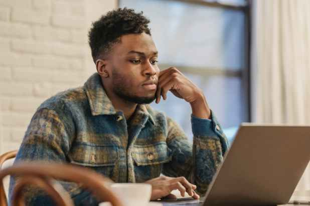 Remote full-time jobs May 2021, Remotasks. Serious black man working on laptop in workspace