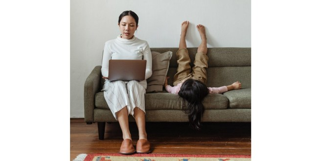 Best paying online jobs. Photo of mother working at home.