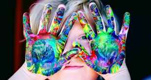 Occupy children. A kid with multicolored hand paint