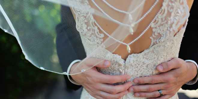 Honeymoon. Woman wearing beige bridal gown during day time