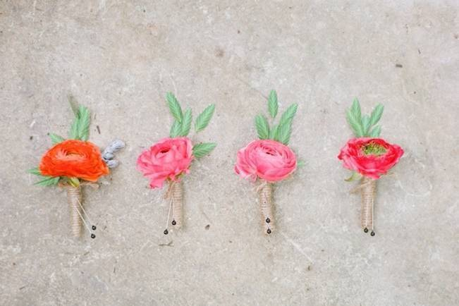 hot pink orange red ranunculus boutonniere