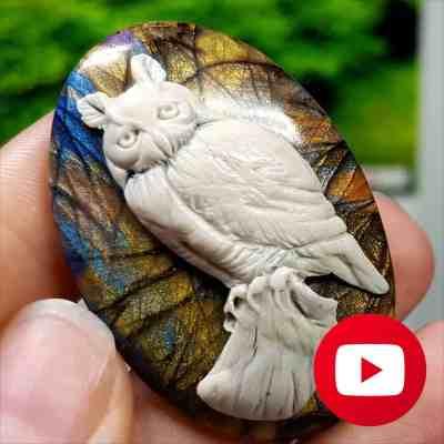 Realistic Faux carved bone Cameo vs Labradorite stone