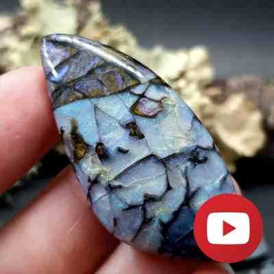 Realistic boulder opal stone. Unique technique