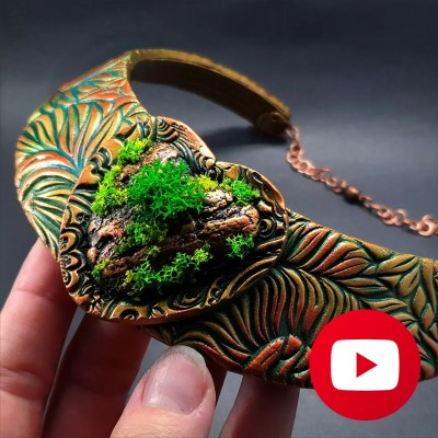 Necklace with nature motives: fern, tree bark, moss