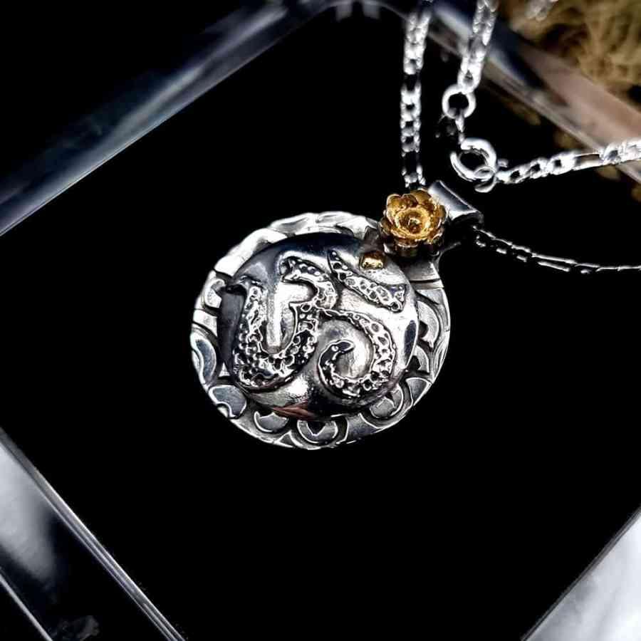 Unique silver OM sign pendant (1 of 1)