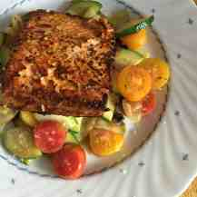 Pan Seared Salmon on a bed of Sautéed Zucchini and Cherry Tomatoes