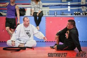 Josh Lanier (left) talks witch coach Lenny Lovato (right)