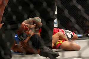 A moment after the above picture was taken, Cruz (red shorts) locked Gonzales' arm between the legs which finished the submission quickly.