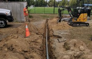 Trenching services, a water pipe in a dirt trench