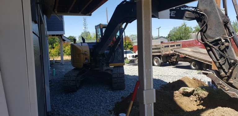 Excavation contractors close to house