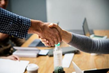 Shaking Hands - Partner With Local Businesses