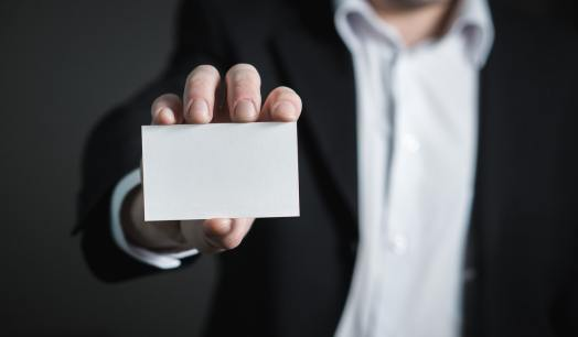 man holding business card - contractor lead generation