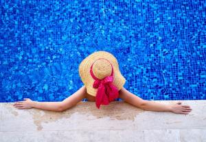 person lounging in pool - pool safety