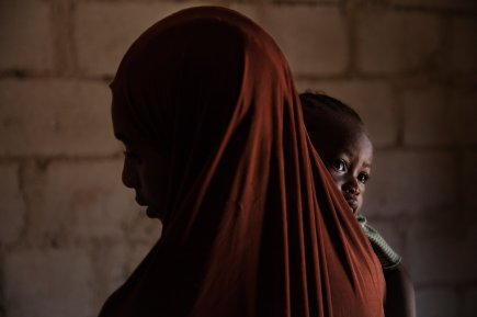 Aisha A., 15, holds her 1-year-old daughter Hadiza, who was born in captivity.