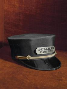 PULLMAN PORTER CAP - In the 1920s the Pullman Company was the nation's largest employer of black men. Train porters were relatively well paid and respected in the black community. In 1925 they unionized; the Brotherhood of Sleeping Car Porters became a force in the march toward equality. (Credit: All Artifacts from the collection of the Smithsonian National Museum of African American History and Culture / Gift of the Descendants of Garfield Logan.)