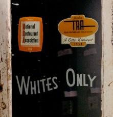 WHITES ONLY - A door from a San Antonio restaurant alerting patrons it served white customers only. (Credit: All Artifacts from the collection of the Smithsonian National Museum of African American History and Culture/ Photo by Lexey Swall / New York Times)