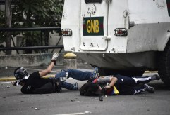 Opposition activists are run over by a charging National Guard riot control vehicle during a protest against Venezuelan President Nicolas Maduro, in Caracas on May 3, 2017. (Photo: Carlos Becerra / AFP / Getty)