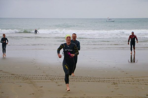 smiling running out of the water