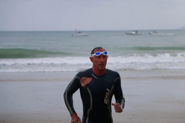 Ripped wetsuit swimmer