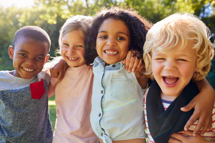 4 children smiling and laughing