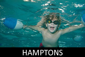 young boy swimming underwater in the hamptons