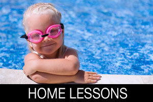 young boy with goggles on in home pool