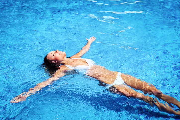 Girl taking a morning swim to lower stress levels
