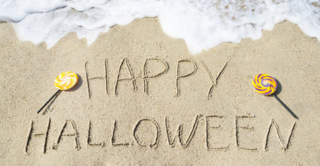 Happy Halloween Written In Sand