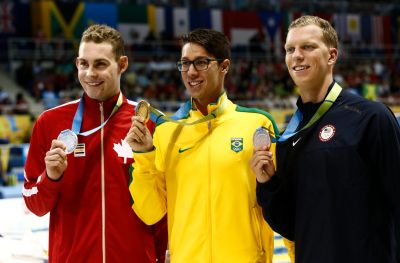Jul 17, 2015; Toronto, Ontario, CAN; Luke Reilly of Canada (left) , Brandonn Almeida of Brazil (middle) and Max Williamson of the United States (right) pose with their medals after the men's swimming 400m individual medley final the 2015 Pan Am Games at Pan Am Aquatics UTS Centre and Field House. Mandatory Credit: Rob Schumacher-USA TODAY Sports