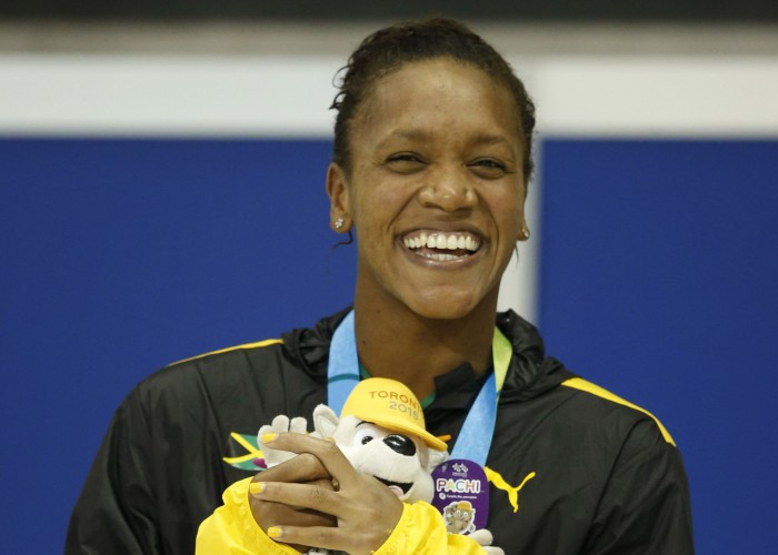 Jul 17, 2015; Toronto, Ontario, CAN; Alia Atkinson of Jamaica celebrates after placing second in the women's 100m breaststroke final the 2015 Pan Am Games at Pan Am Aquatics UTS Centre and Field House. Mandatory Credit: Erich Schlegel-USA TODAY Sports