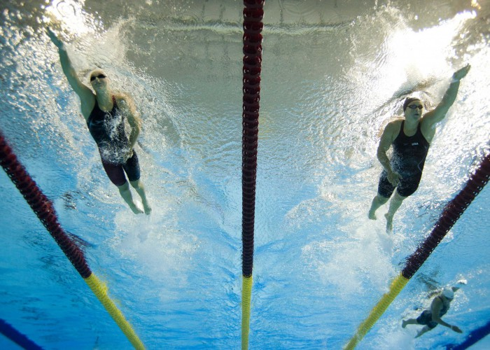 Jul 16, 2015; Toronto, Ontario, CAN; Caitlin Leverenz of the United States (right) races Emily Overholt of Canada (left) in the women's swimming 400m individual medley final during the 2015 Pan Am Games at Pan Am Aquatics UTS Centre and Field House. Mandatory Credit: Erich Schlegel-USA TODAY Sports
