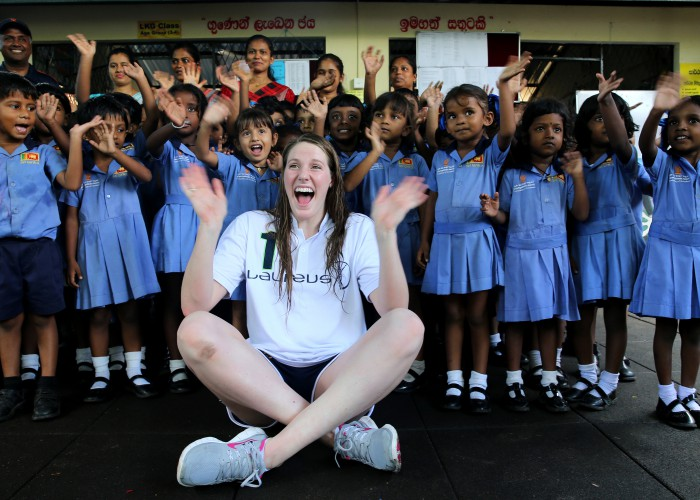 SEENIGAMA, SRI LANKA-OCTOBER 6, 2015: Laureus Ambassador and Olympic gold medalist Missy Franklin poses a picture with children at Foundation of Goodness during the Missy Franklin Sri Lanka Project Visit on October 6, 2015 in Seenegama, Sri Lanka. (Photo by Buddhika Weerasinghe/Laureus/Getty Images)